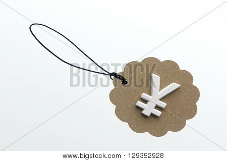 Yen sign on cardboard tag on white background.Isolated