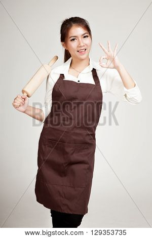Asian Baker Woman  In Apron  Show Ok With Wooden Rolling Pin