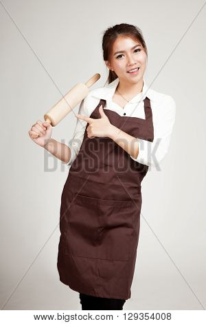 Asian Baker Woman  In Apron Point To Wooden Rolling Pin