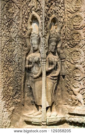 A Bas-Relief Statue of Khmer Culture at Ta Prohm temple Cambodia