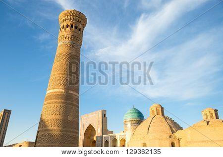 Uzbekistan Bukhara the Kalon minaret and the Mir-i-Arab madrassah in the background