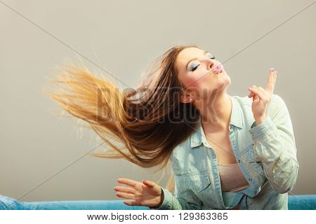 Fashionable Girl With Long Hair Blowing