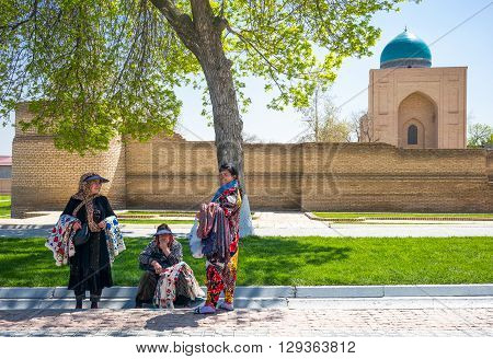 Samarkand Uzbekistan - April 18 2014: Local craft vendors near Registan square