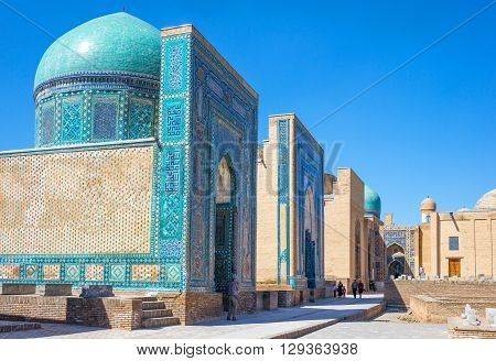Samarkand Uzbekistan - April 18 2014: Local people in the Shakhi Zinda Ensemble