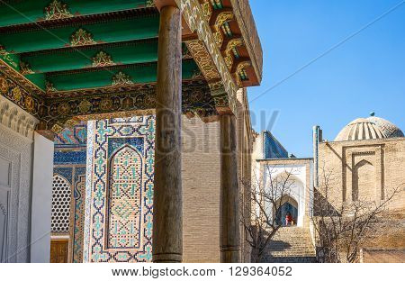 Samarkand Uzbekistan - April 18 2014: Local people at the entrance of the Shakhi Zinda Ensemble