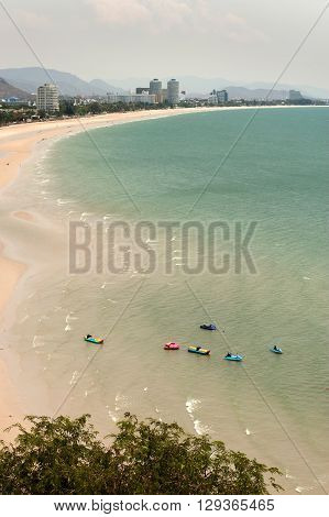 Scenic view Hua-Hin beach from Wat Khao Takiab temple,Hua Hin's beach is very popular beach both single and family visitor. The white sandy beach length around 7-kilometer and lined with a wide range of accommodations, from bungalows to five-star hotels
