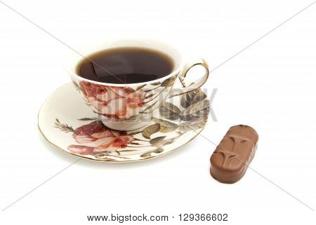 Cup Of Tea And Chocolate On White