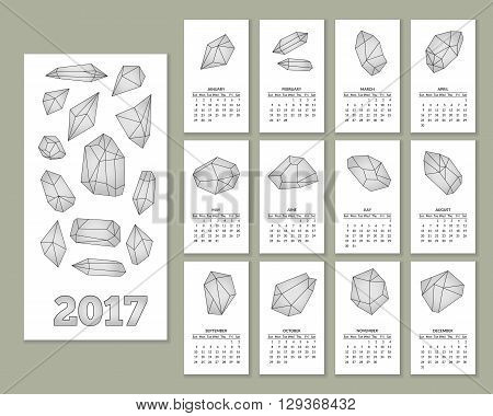 Monthly wall calendar for year 2017 with geometric polygonal crystals in flat style isolated on white background. Week starts with Sunday. 2017 calendar. Easy to edit template. Vector illustration.