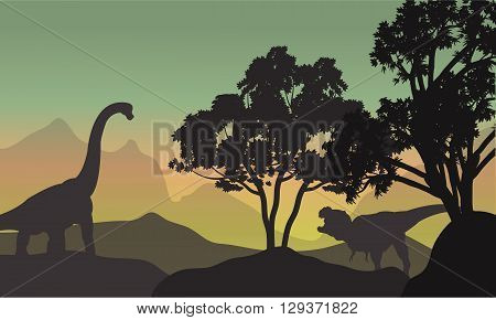 Silhouette of brachiosaurus and T-Rex in hills at the morning