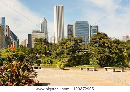 CHICAGO, ILLINOIS - AUGUST 22, 2015: Chicago skyline seen from an area of Grant Park. The park is in the Loop area of the city.