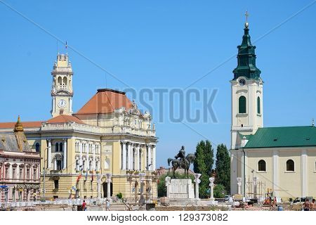 Oradea City Town Hall in Union Square at the time of the work in progress to renew the paving,  Romania