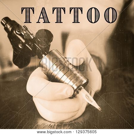 Tattoo artist at work close up. Retro stylization