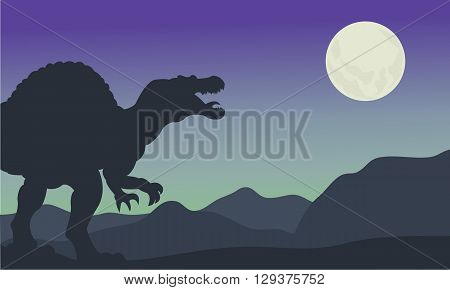 Silhouette of spinosaurus at the night in hills