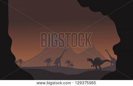 Silhouette of spinosaurus and brachiosaurus in the hills