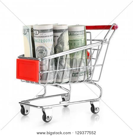 Shopping cart with dollars inside isolated on white