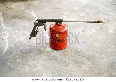 Old red spray gun in the garage
