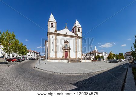 Facade of Santa Maria da Devesa church, the mother church of Castelo de Vide and Dom Pedro V square, Alto Alentejo, Portugal.
