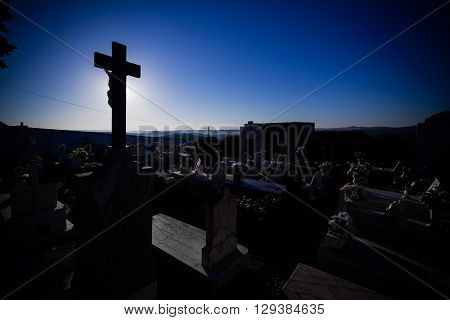 Silhouette of the gravestones on a typical Catholic cemetery in the interior south of Portugal.