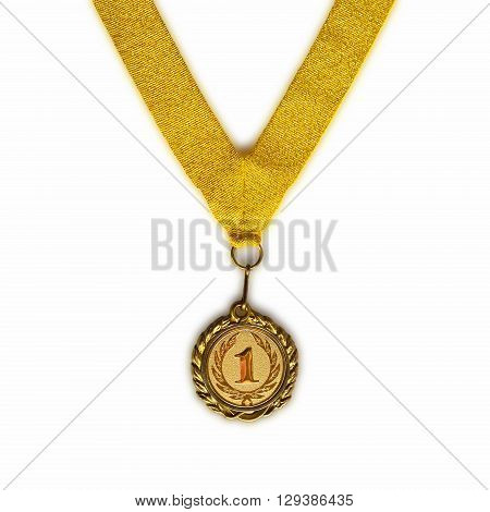 Gold medal on gold ribbon with relief detail of laurel wreath and number one isolated on white background