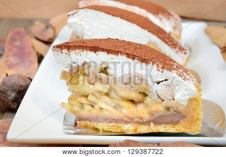 Banoffee pie on wooden table in soft light, Selective focus and close up