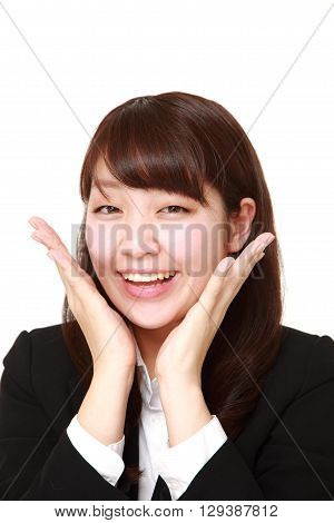 portrait of young Japanese businesswoman pleased on white background