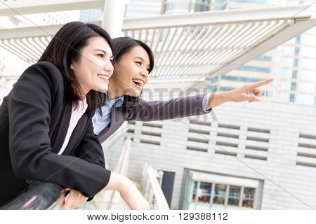 Business woman finger pointing far away