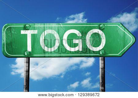 Togo, 3D rendering, a vintage green direction sign