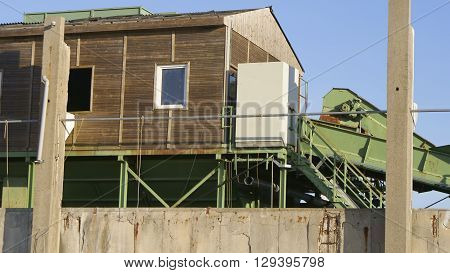old waste sorting in an industrial ruin with no roof