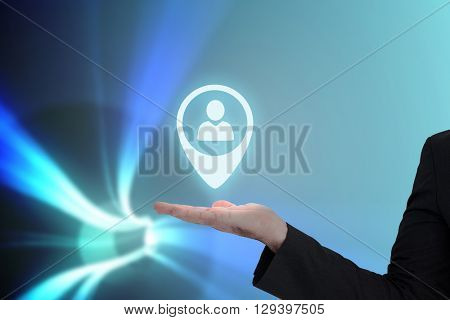 Businessman with his hand out against blue vortex with bright light