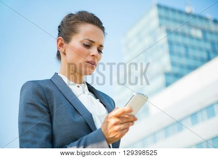 Business Woman In Modern Office District Reading Sms