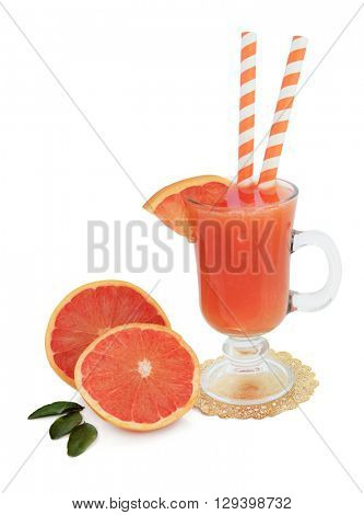 Ruby red grapefruit juice drink in a glass on a gold doilie with fresh fruit and striped straws over white background. High in vitamins, anthocyanins and antioxidants.