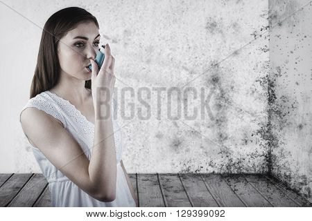 Portrait of an asthmatic woman against image of a room corner