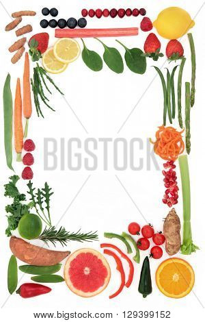 Paleo diet health food of fruit and vegetables forming an abstract border over white background. High in vitamins, antioxidants, minerals and anthocyanins.