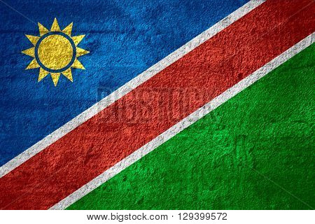 flag of Namibia or Namibian banner on rough texture