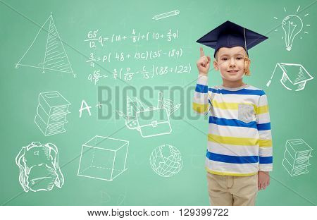 childhood, school, education, knowledge and people concept - happy boy in bachelor hat or mortarboard and eyeglasses over doodles on green chalk board background
