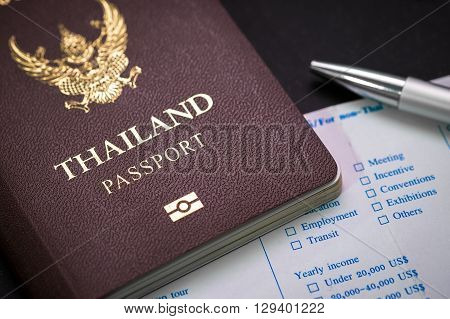 Thai Passport and customs form and pen. concept of travel and business.