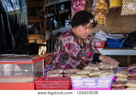 Ranau,Sabah,Malaysia-Nov 12, 2015:Local woman selling various local food product at a local market called 'Tamu' in Ranau,Sabah,Malaysia.Tamu is very famous in Sabah of Borneo for purpose of business