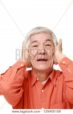 portrait of senior Japanese man suffers from noise