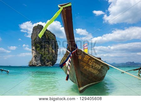 CRABI PROVINCE THAILAND - FEBRUARY 02 2015: Traditional thai long tail boat waiting for tourists to travel to beautiful islands in Thailand