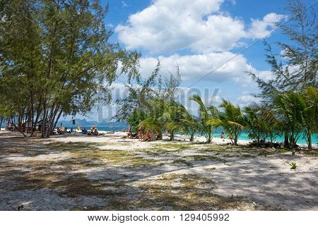 CRABI PROVINCE THAILAND - FEBRUARY 02 2015: Tourists relaxing on the white sand beach of Andaman sea at Krabi province Thailand