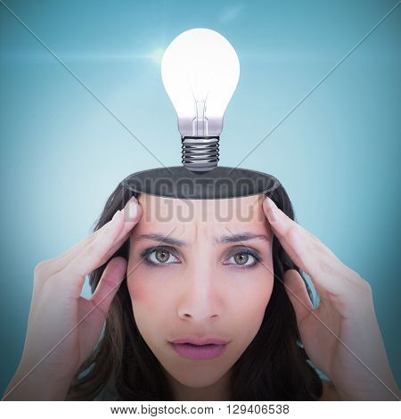 Pretty brunette with a headache against blue vignette background