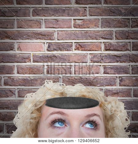 Close up of pretty blonde woman looking up against image of a wall