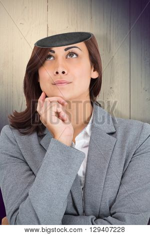 Focused businesswoman against shadow on wooden boards
