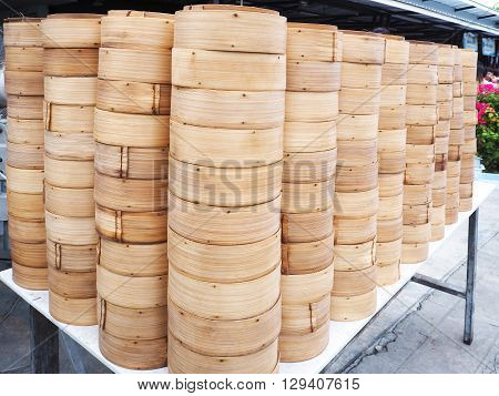 Stack of bamboo steamed dim sum container on the table at Chinese restaurant in Phuket Thailand