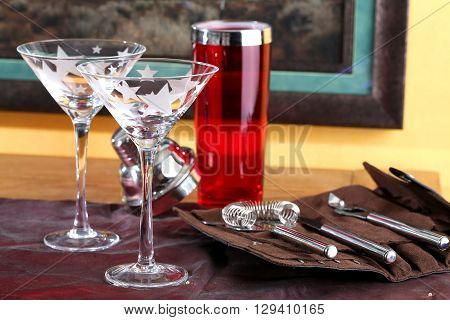 Martini glasses with martini serving tools at the ready