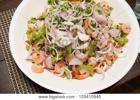 Thai Spicy salad with shrimp and vegetables on white dish