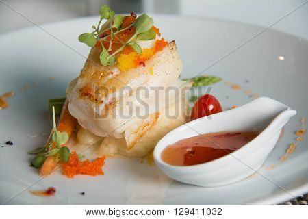 Gourmet Main Entree Course Grilled Snow Fish with sauce.