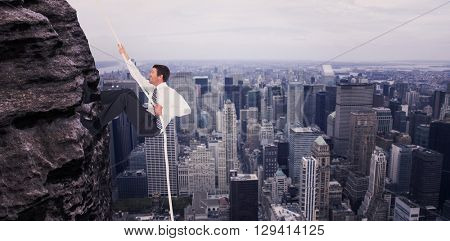 Businessman pulling a rope against image of a city landscape