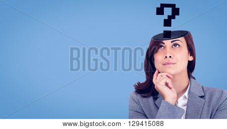 Focused businesswoman against blue background