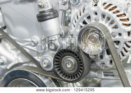 close-up to the alternator with the car engine